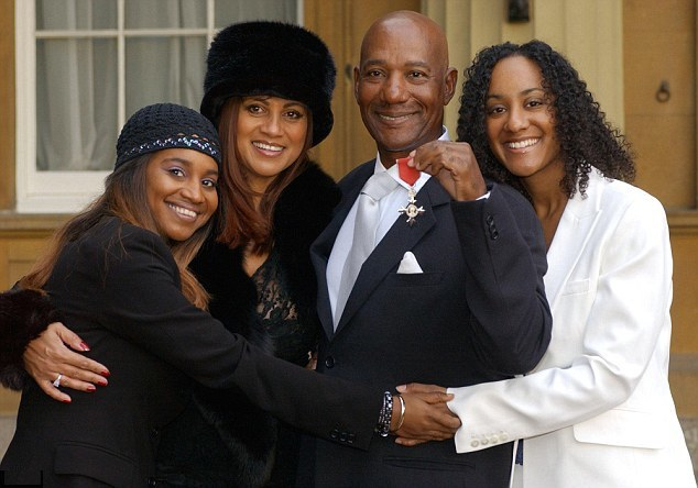 Errol Brown pictured with his wife Ginette and daughters Leonie & Collette, received an MBE in 2003