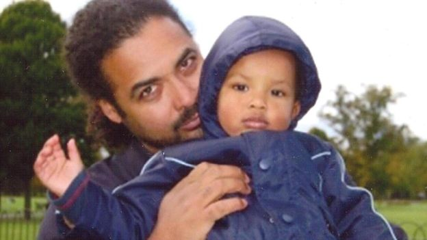 Arthur Simpson-Kent pictured with his son Amon, is a person of interest in the murders of his partner and sons.